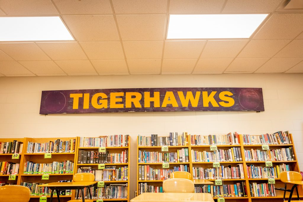 Collection of Books with Tigerhawks sign above them